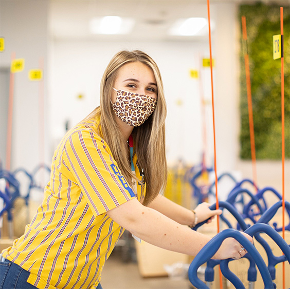 Happy IKEA employee wearing a mask for protection